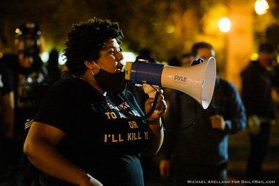 Black Lives Matter organizer Bailey W., 24, speaks to the crowd outside the Mark O. Hatfield federal courthouse. Ongoing protests against police brutality on Friday, July 17, 2020, in Portland, Ore. (Michael Arellano for DailyMail.com)