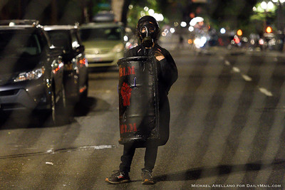 A protestor is seen inside the Chinook Land Autonomous Territory perimeter fencing. Ongoing protests against police brutality on Friday, July 17, 2020, in Portland, Ore. (Michael Arellano for DailyMail.com)