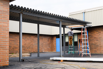 New covered walkway under construction at Gubser Elementary on Friday, August 16, 2019, in Keizer, Ore.