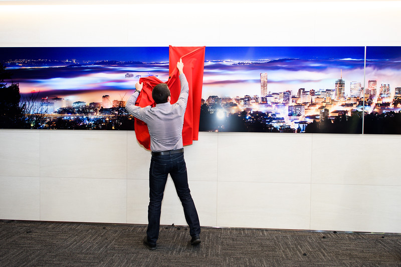 "Photographer Michael Cary Arellano unveils his photograph ""Above the Clouds."" Unico Properties hosts an art installation of the 25-foot wide, three-panel panoramic photo of downtown photo in U.S. Bancorp Tower lobby on June 29, 2016. Taken by Portland photographer Michael Cary Arellano and printed directly on metal, ""Above the Clouds"" is the largest metal photograph ever sold in the U.S. (Credit: Molly J. Smith)"