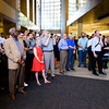"The assembled crowds awaits the unveiling of ""Above the Clouds."" Unico Properties hosts an art installation of the 25-foot wide, three-panel panoramic photo of downtown photo in U.S. Bancorp Tower lobby on June 29, 2016. Taken by Portland photographer Michael Cary Arellano and printed directly on metal, ""Above the Clouds"" is the largest metal photograph ever sold in the U.S. (Credit: Molly J. Smith)"