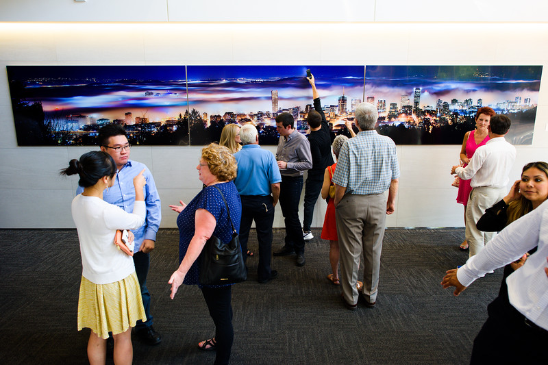 "Unico Properties hosts an art installation of the 25-foot wide, three-panel panoramic photo of downtown photo in U.S. Bancorp Tower lobby on June 29, 2016. Taken by Portland photographer Michael Cary Arellano and printed directly on metal, ""Above the Clouds"" is the largest metal photograph ever sold in the U.S. (Credit: Molly J. Smith)"