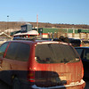 Parking lot of one grocery store. Mountains both sides of skinny Ft McMurray. file 548