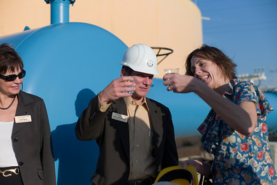 Commerce Bureau Director of Export Development Mary Regal, Secretary of Commerce Dick Leinenkugel and Aquarius Systems President Jane Dauffenbach toast with the final product from the Ashkelon Desalination plant.
