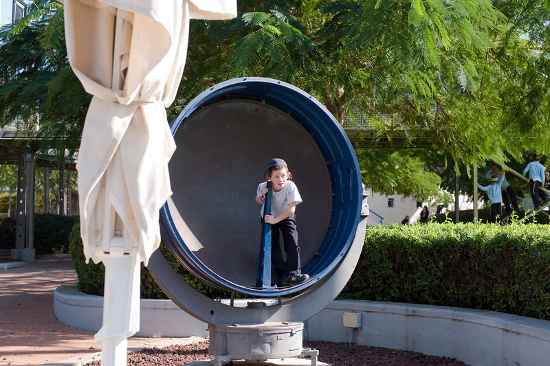 A boy playing and learning about acoustic waves at the Clore Garden of Science.