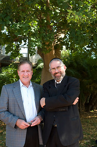 Chancellor Carlos Santiago and Rabbi at Clore Garden of Science.