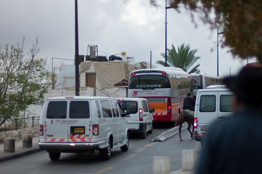 The traffic is certainly vibrant and includes horses right outside the Dung Gate to Old City.
