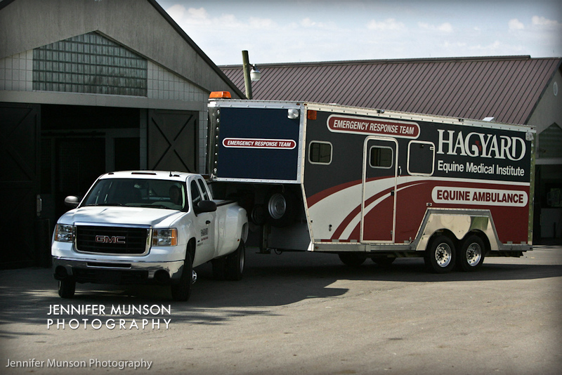 Ambulance against barn