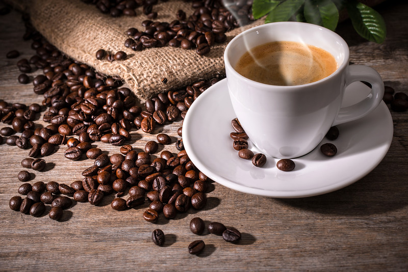 //www.dreamstime.com/stock-images-espresso-coffee-cup-beans-wooden-background-image36989724