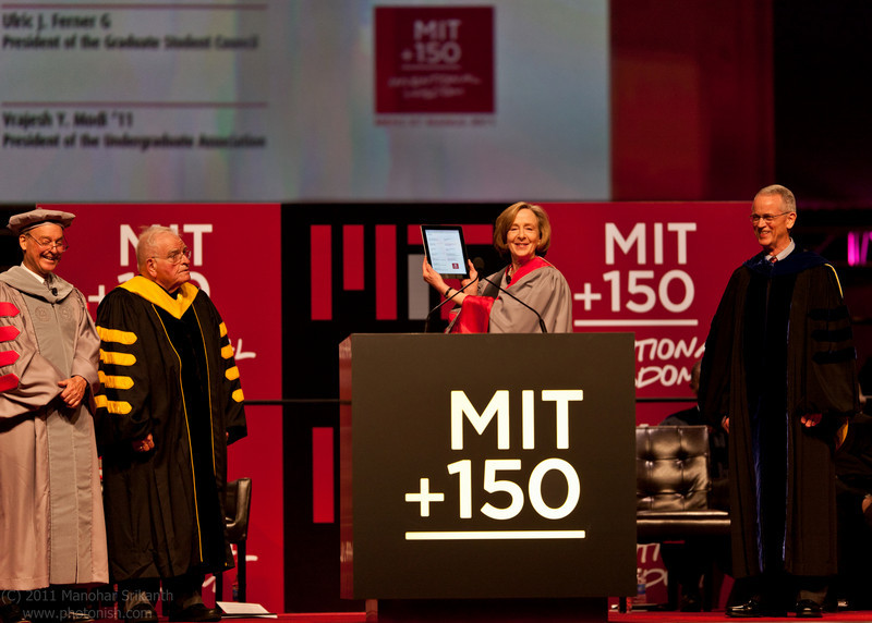 President Susan J. Hockfield holds an Apple iPad, used for its touch interface to sign a renewal of MIT's charter, flanked (from left) by Chairman of the MIT Corporation John S. Reed '61 and former Presidents Paul E. Gray '54 and Charles M. Vest at the MIT Next Century Convocation this past Sunday at the Boston Convention and Exhibition Center. See page 9 for more photos of the convocation