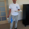 Jesus Cornejo. Contractor for Drywall, Painting, Suspended Ceilings. The blue tape on his pants are punch-list markers taken from the walls. He is using a touch-up palette made from a paint can top. Forgot to ask him what the materials are he is carrying around. One is the paint..... but the other?