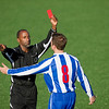"""Good strong image of ref enforcing rules. Licensed to Metapower from Istock. May not work in this blog if I use the other """"close up red card"""" image. [Soccer player receiving a red card from the match referee]"""