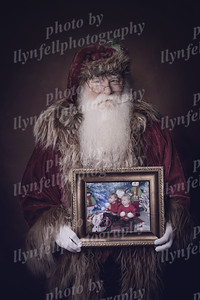 Darcy and Mali Old Santa with frame 20x13x300 Moon Dance