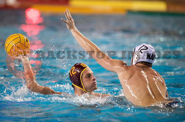 06 December 2008: USC Trojans two-meter Jovan Vranes (12) looks to shoot past Navy Midshipmen left-hander Johnny Meiners (12) during the Trojans 14-9 win over the Midshipmen in the NCAA men's water polo championship semi-final game at the Avery Aquatic Center in Stanford, CA.