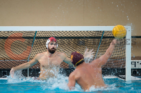 07 December 2008: USC Trojans two-meter Shea Buckner (8) takes a penalty shot at Stanford Cardinal goalkeeper Jimmie Sandman (1) during the Trojans's 7-5 win over the Cardinal in the NCAA men's water polo championship final game at the Avery Aquatic Center in Stanford, CA.