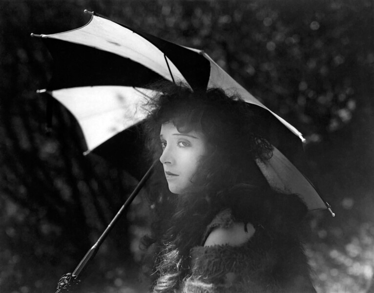 "Madge Bellamy in a Scene from ""Secrets of the Night"" 1924"