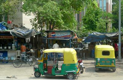 Tuk Tuks at a market