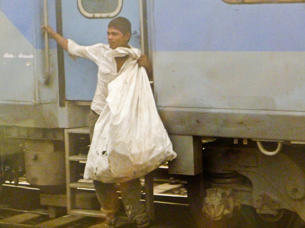 Young boy collecting trash from the train-2