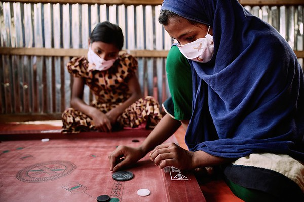 0010-0011-WASH-22nd February -2021 Atiya Khatun,11 loves to play Carrom Board with her best friend Asma Khatun, 10, loves to play inside the hub during COVID 19 pandemic. All schools are closed so UNICEF provided Child Protection & Emergency Flood Response Project Hub is the only place she can spend time with her friends. Supported by UNICEF, Implemented by GUK and GOV of Bangladesh. Village Pachgachy, Zatrapur Union, Kurigram District, Bangladesh.  Photo: Bashir Ahmed Sujan / Map