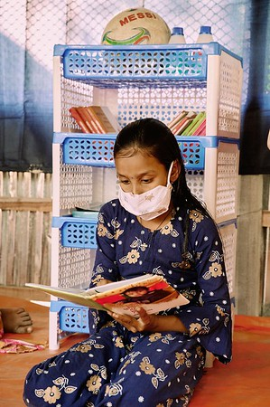 0001-0005-WASH-22nd February-2021 Masuda Khatun, 10, is Studying in class five at Pachgachy Government Primary School.  She loves to read stories and play Ludo when she visits the hub provided by UNICEF (CP&EFRP). She doesn't like wearing a mask but this is mandatory because of the COVID 19 pandemic when she goes out of her home. She is the eldest among her two brothers & sister. Her Father Mokhlesur Rahman is a farmer and her mother Asma Begum is a housewife. During COVID 19 pandemic the school is closed so UNICEF provided Child Protection & Emergency Flood Response Project Hub is the only place she can spend time with her friends. Supported by UNICEF, Implemented by GUK and GOV of Bangladesh. Village Pachgachy, Zatrapur Union, Kurigram District, Bangladesh.  Photo: Bashir Ahmed Sujan / Map