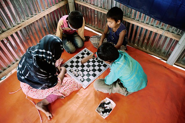 0012-0014-WASH-22nd February -2021 Boys and girls are playing Chess and Ludo inside the hub During COVID 19 pandemic. All schools are closed so UNICEF provided Child Protection & Emergency Flood Response Project Hub is the only place she can spend time with her friends. Supported by UNICEF, Implemented by GUK and GOV of Bangladesh. Village Pachgachy, Zatrapur Union, Kurigram District, Bangladesh.  Photo: Bashir Ahmed Sujan /Map