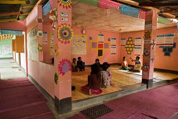 UNICEF-IcSP-SH-0235-0237 Interior of the Burmapara social hub, where children are having a play session. EU IcSP Social Hub, supported by UNICEF, Implemented by BITA. Near Camp 15, Ukhia, Cox's Bazar, Bangladesh. Photo: b.a. sujaN / UNICEF / Map