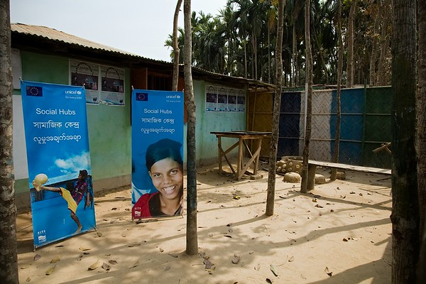 UNICEF-IcSP-SH-0230-0234 Burmapara social hub courtyard, where children are playing outside EU IcSP Social Hub, supported by UNICEF, Implemented by BITA. Near Camp 15, Ukhia, Cox's Bazar, Bangladesh. Photo: b.a. sujaN / UNICEF / Map