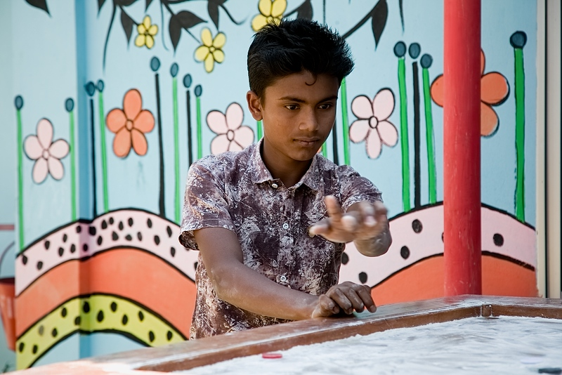 UNICEF-IcSP-SH-0001-0005  Mohammad Jashim (16), (Case Study) He is the elder son in the family,3 brothers and 2 sisters living with parents inside camp-15, Jamtoli. Father Mojibur Rahman is a day labourer.  Playing Ceram board with friends outside of EU IcSP Social Hub, supported by UNICEF, Implemented by BITA. Near Camp 15, Ukhia, Cox's Bazar, Bangladesh. Photo: b.a. sujaN / UNICEF / Map