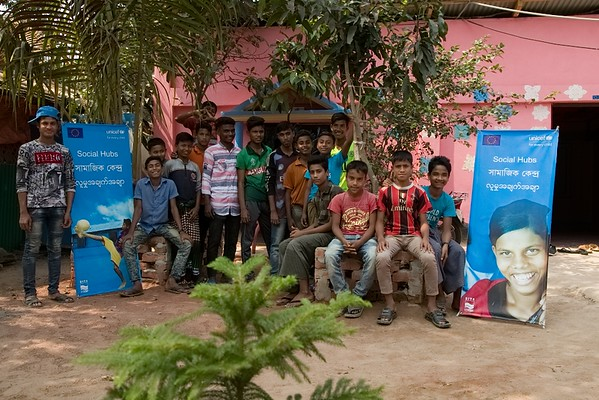UNICEF-IcSP-SH-0326-0328 Host Community boys group photo session. EU IcSP Social Hub, supported by UNICEF, Implemented by BITA. Near Camp 15, Teknaf, Cox's Bazar, Bangladesh. Photo: b.a. sujaN / UNICEF / Map