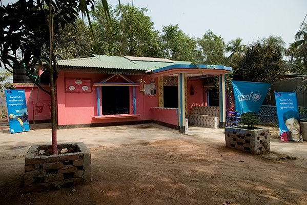 UNICEF-IcSP-SH-0317-0325 Brightly painted exterior of the social hub in Leda.  Leda is situated in the nether-regions of Teknaf. An area rife with unrest and danger. Just the other day, seven people were killed in an altercation between the Rohingya community and RAB (Rapid Action Battalion) - the anti-crime unit of the Bangladesh Police force in the neighbouring area of Jadimura. All the more reason, Leda's Bita social hub is a safe-haven for adolescent boys and girls to enjoy whatever childhood remains before they are forced to be adults.  EU IcSP Social Hub, supported by UNICEF, Implemented by BITA. Near Camp 15, Teknaf, Cox's Bazar, Bangladesh. Photo: b.a. sujaN / UNICEF / Map