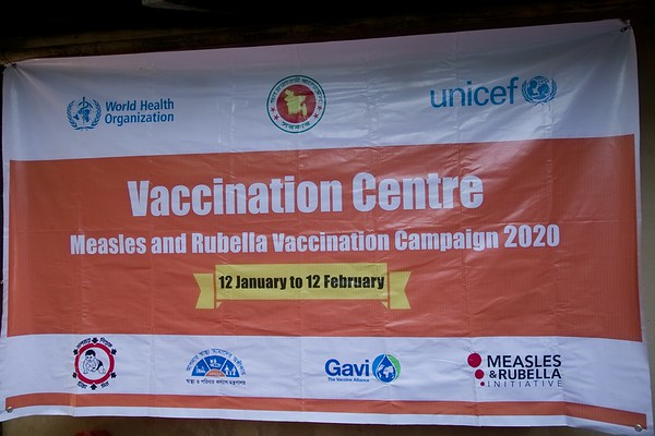 UNICEF-RR-MRVC-0150  Measles- Rubella Vaccination Campaign Banner displayed inside the Rohingya refugee camp. Government of Bangladesh, UNICEF, WHO, Gavi and health partners are launching a massive vaccination camping to keep 300,000 Roningya children safe. Camp 2, Ukhia, Cox's Bazar, Ukhia, Cox's Bazar, Bangladesh. Photo: b.a. sujaN / UNICEF / Map