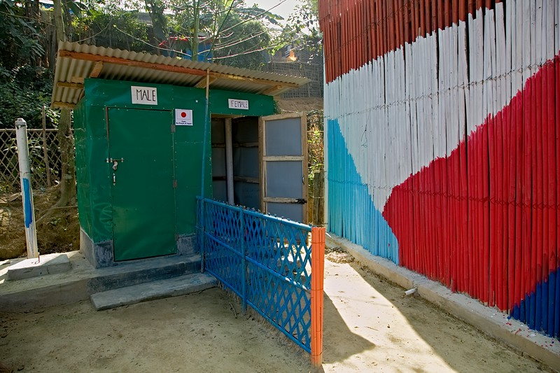 UNICEF-RR-MPC-0010-0011  Toilet Facilities for Rohingya Children and Adolescents inside Multi-Purpose Child and Adolescent Center Funded by the people of JAPAN; Supported by UNICEF; Implemented by CODEC Camp 1E, Block D, Lambashia Road, Rajapalong, Ukhia, Cox's Bazar, Bangladesh. Photo: b.a. sujaN / UNICEF / Map