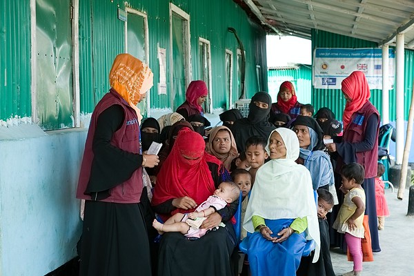 UNICEF-RR-PHC-1325-1330  A team of volunteers helping community people to get proper survices with their prescriptions and Refuggeee ID card at RTMI- Primary Health Care Centre,   Funded by Japan, Suppoorted by UNICEF, Implememted by RTM Iternational. Camp-18.  Ukhia, Cox's Bazar. Photo: b.a. sujaN / UNICEF / Map