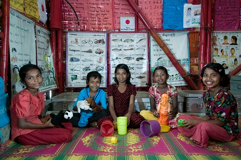 UNICEF-RR- PCLC -0368-0383  Rohingya Girls smiling and Posing for photos with their favorite Legos, hand puppets, inside Pahartali Child Learning Center-1. Supported by UNICEF Funded by the people of JAPAN from Reaching out of School Children (ROSC) and (MoPME) Phase II Project. Implemented by Mukti Cox's Bazar. Camp 04, Block A-7, Ukhia, Cox's Bazar, Bangladesh. Photo: b.a. sujaN / UNICEF / Map