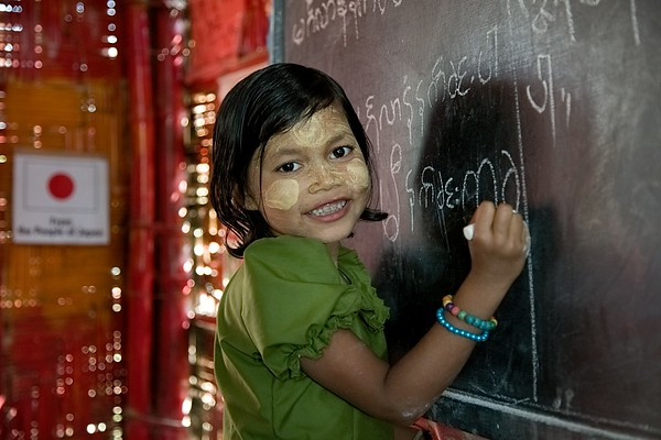 UNICEF-RR- PCLC -0304-0306  Mazeda is a Seven-year old Rohingya child. She is learning to write Rohingya alphabets on black board, and is also smiling for Photos. Pahartali Child Learning Center-2. Supported by UNICEF Funded by the people of JAPAN from Reaching out of School Children (ROSC) and (MoPME) Phase II Project. Implemented by Mukti Cox's Bazar. Camp 04, Block A-7, Ukhia, Cox's Bazar, Bangladesh. Photo: b.a. sujaN / UNICEF / Map