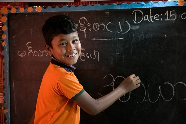 UNICEF-RR- PCLC -0320  Rohimullah is ten years old Rohingya child learning to write Rohingya alphabets on black board and also smiling for Photos. Pahartali Child Learning Center-2. Supported by UNICEF Funded by the people of JAPAN from Reaching out of School Children (ROSC) and (MoPME) Phase II Project. Implemented by Mukti Cox's Bazar. Camp 04, Block A-7, Ukhia, Cox's Bazar, Bangladesh. Photo: b.a. sujaN / UNICEF / Map