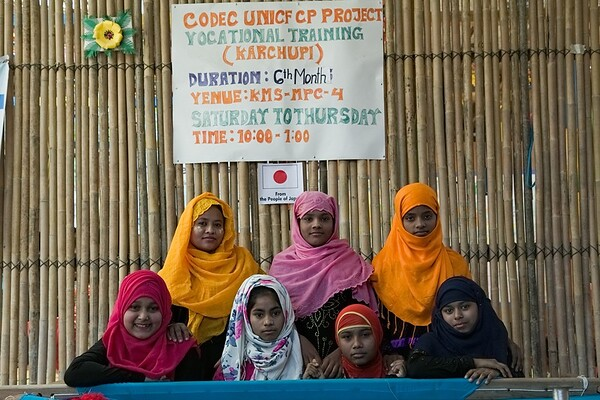 UNICEF-RR-MPC-0104-0108  Minara (18), Sufia (13), Ateka (16), Rehana (15), Rokia, Mahfuja, Hasina Posing for a group Photo. A group of Adolescent Girls Learning Vocational Training on Karchupi inside Multi-Purpose Child and Adolescent Center. Funded by the people of JAPAN; Supported by UNICEF; Implemented by CODEC Camp 1E, Block D, Lambashia Road, Rajapalong, Ukhia, Cox's Bazar, Bangladesh. Photo: b.a. sujaN / UNICEF / Map