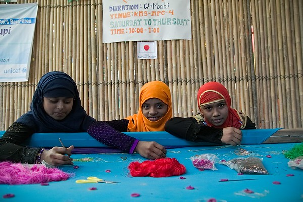 UNICEF-RR-MPC-0118-0119  Rokia, Mahfuja, Hasina posing for photo while she is Learning Karchupi inside Multi-Purpose Child and Adolescent Center. Funded by the people of JAPAN; Supported by UNICEF; Implemented by CODEC Road, Rajapalong, Ukhia, Cox's Bazar, Bangladesh. Photo: b.a. sujaN / UNICEF / Map