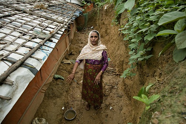 UNICEF-0034-0045  Noor Jahan is 50-year-old. She has a family of five including three children. They live in Jamtoli camp in Cox's Bazar. Her shelter has been damaged by a landslide during the recent spate of heavy monsoon rain.  Camp-15, Jamtoli, Ukhia, Cox's Bazar. Photo: b.a. sujaN / UNICEF / Map