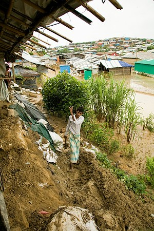 UNICEF-0157-0163  Karim Ullah (24), has a family of four including two children. He is trying to fix his shelter in Camp 8, Balukhali, Ukhia, Cox's Bazar. Bangladesh. This house has been damaged by a landslide last night due to heavy monsoon rain.  Camp 8, Balukhali, Ukhia, Cox's Bazar. Bangladesh. Photo: b.a. sujaN / UNICEF / Map