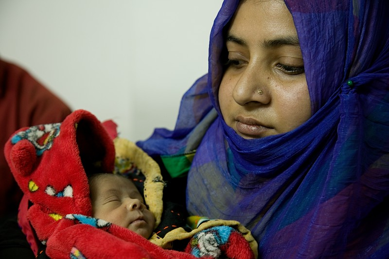 UNICEF- Nutrition -0655-0661  Name of the child N/A. (14 days old). Adopted father Ruhul Amin, mother Hasina Begum.  The baby's mother died just three days after she was born. Ruhul and Hasina decided to adopt the child. However, nobody could breastfeed the child. Hasina introduced bottle feeding to the child that caused health problems such as abdominal swelling, sore on lips, and poor digestion. The doctor has recommended for them to find a wet nurse for this child to ensure they receive enough nutrients for healthy growth and development.   Cox's Bazar General Hospital Photo: b.a.sujaN / UNICEF / Map