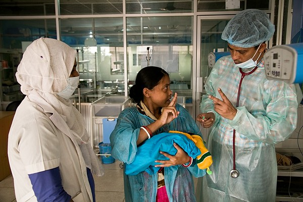 Special Care Newborn Unit  UNICEF-SCANU-0667-0675  DR. M S Zaman, Assistant Professor (Paediatrics) explains how SCANU helps sick newborns in Cox's Bazar district.  Mother Tumpa (22) from Sadar, Cox's Bazar Tumpa's twins were admitted to SCANU at 14 days. They were suffering with infections and low birth weight (LBW). Tumpa is physically and mentally impaired with hearing problems. Initially, she did not know how to breastfeed her children but she was taught how to do so, which is an important part for her twins recovery and development.   UNICEF supported the establishment of the Special Care Newborn Unit (SCANU) in Cox's Bazar District Hospital in 2012. Specialized newborn care can reduce newborn deaths by 30%. Over 3,300 babies were admitted to SCANU in 2018, including 245 Rohingya newborns. 86% of sick newborns admitted to SCANU survived in 2018. UNICEF is continuing its support to the National Health Programme to expand the reach of SCANU across all 64 districts in Bangladesh and continue to improve the quality of care delivered.    Name of the nurse: Fatema Begum . Cox's Bazar General Hospital Photo: b.a.sujaN / UNICEF / Map