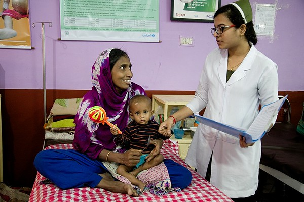 UNICEF-SAM-0728-0736  Name of the nurse: Snigdha Das Name of the child: Musa (14months), Mother: Parvin Akter (27yrs), Father: Nurul Absar, Address: Eid-gah, CXB  Admission date: 5/1/2019  MUAC: 11cm, Weight: 5.5 Kg, Z-score: <-3SD  Medical complications: SAM with fever.  Current situation: MUAC and weight is improving gradually.   Cox's Bazar General Hospital. Photo: b.a.sujaN / UNICEF / Map
