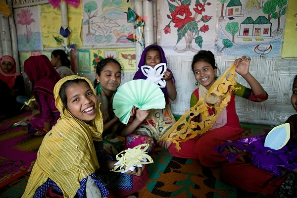 UNICEF-AFS-0058-0070  Rohingya Adolescent girls make decorative paper crafts and flowers and enjoy spending time together inside Adolescent Friendly Space (AFS) at Baharchora, Shamlapur Makeshift Settlement, Teknaf, Cox's Bazar.   UNICEF supported 60 Adolescent Friendly Spaces and 220 Adolescent Clubs in the Rohingya refugee camps in 2018. Through these facilities, UNICEF reached 40,000 adolescents with a range of protection services and learning opportunities. Adolescent-Friendly Spaces offer life skills based education, case management and recreational activities. Participating adolescents follow a four-month-long course, attending sessions for four hours a week on topics such as health and nutrition; prevention of HIV/AIDS; gender and GBV; child marriage; child labour; trafficking; peace building; leadership; employability skills; values and ethics; and equality and equity.  AFS at Baharchora, Shamlapur Makeshift Settlement, Teknaf, Cox's Bazar. Photo: b.a.sujaN / UNICEF / Map