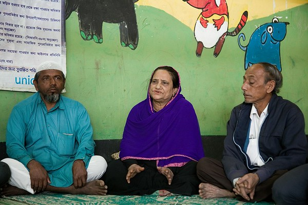 UNICEF- CBCPC 0119-0120  Shamsun Nahar, social worker and respected member of Community-Based Child Protection Committee (CBCPC), discusses with fellow committee members about child marriage and impact of drug use and drug trafficking in the host community.  UNICEF provides support to host-community children and adolescents through its 10 Child-Friendly Spaces (CFS) and 90 Adolescent Clubs (AC) in the host community. UNICEF reaches 9,000 children and 4,000 adolescents at these facilities. Parents and care givers of the children and adolescents take part in Community-Based Child Protection Committees (CBCPCs). The CBCPCs serve as platforms to improve community awareness on child protection to prevent violence, abuse, neglect and exploitation. They serve as a watchdog and first line of reporting abuse, while referring survivors for counselling and services. In total, 83 members from CBCPCs are working to improve the protective environment for children and adolescents.   Balukhali, Teknaf, Cox's Bazar. Photo: b.a.sujaN / UNICEF / Map