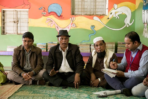 UNICEF- CBCPC -0113-0116  Monirul Haque president of the Community-Based Child Protection Committee (CBCPC) meets with parents and members of the CBCPC. They discuss education challenges for young adolescents and the consequences of drug use and trafficking in the host community.  UNICEF provides support to host-community children and adolescents through its 10 Child-Friendly Spaces (CFS) and 90 Adolescent Clubs (AC) in the host community. UNICEF reaches 9,000 children and 4,000 adolescents at these facilities. Parents and care givers of the children and adolescents take part in Community-Based Child Protection Committees (CBCPCs). The CBCPCs serve as platforms to improve community awareness on child protection to prevent violence, abuse, neglect and exploitation. They serve as a watchdog and first line of reporting abuse, while referring survivors for counselling and services. In total, 83 members from CBCPCs are working to improve the protective environment for children and adolescents.   Child Friendly Space, Balukhali, Teknaf, Cox's Bazar. Photo: b.a.sujaN / UNICEF / Map