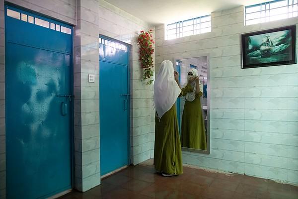 UNICEF-RR-0398 – 0402 A Student Utilizing mirror.  Fatematuz Jahara (R) Girs Dakhil Madrasa. 2no Rotnapalong Union, Ukhia, Cox's Bazar.  Photo: b.a. sujaN / UNICEF / Map
