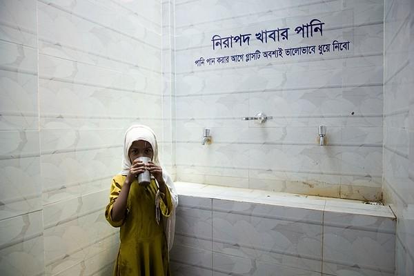 UNICEF-RR-0403 - 0407 A Student Drinking Water. Fatematuz Jahara (R) Girs Dakhil Madrasa. 2no Rotnapalong Union, Ukhia, Cox's Bazar.  Photo: b.a. sujaN / UNICEF / Map