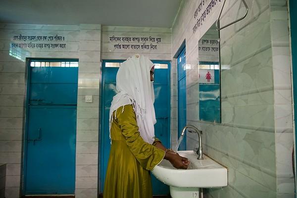 UNICEF-RR-0396 – 0397 A Student washing Hand.  Fatematuz Jahara (R) Girs Dakhil Madrasa. 2no Rotnapalong Union, Ukhia, Cox's Bazar.  Photo: b.a. sujaN / UNICEF / Map