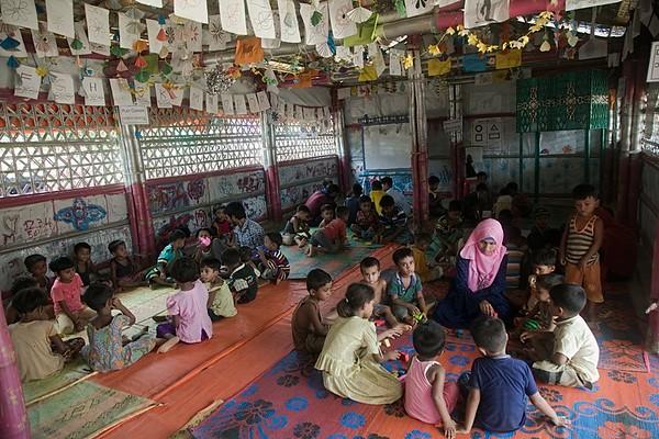 UNICEF-RR-0194-0196  Teachers group activities with Rohingya children inside the  BRAC-UNICEF Multi-Purpose Child and Adolescent Centre.  Camp-18, block G-43, Ukhiya, Cox's Bazar Photo: b.a.sujaN / UNICEF / Map